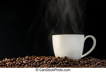 coffee cup with beans on black background