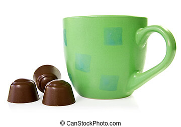 coffee cup with chocolate pralines