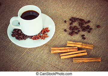 Coffee cup with cinnamon, anise and beans