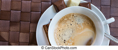 coffee cup  with cinnamon sticks
