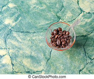 Coffee cup with coffee beans inside
