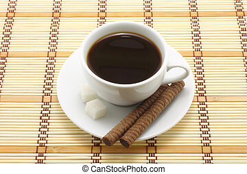 Coffee cup with cookies on a wooden background