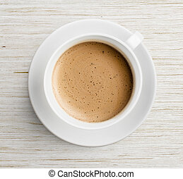 coffee cup with foam on table top view - coffee cup with...