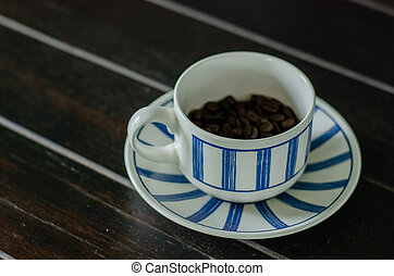 Coffee cup with good quality coffee beans inside 2