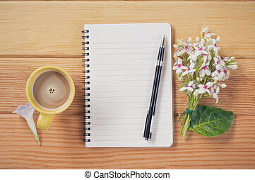 Coffee cup with notebook .