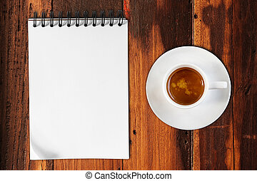 Coffee cup with paper on wood table