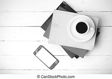 coffee cup with phone and stack of book black and white color