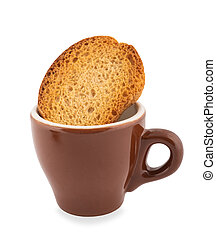 Coffee cup with rusk isolated on white background