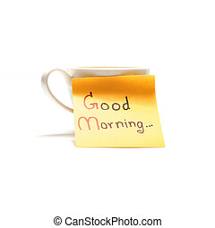 coffee cup with sticky note write Good morning