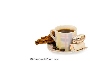 Coffee cup with sweets on white background