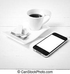 coffee cup with wafer and phone black and white color