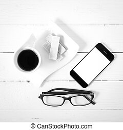 coffee cup with wafer, phone, eyeglasses black and white color