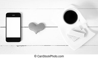 coffee cup with wafer, phone, heart black and white color