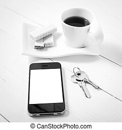 coffee cup with wafer, phone, key black and white color