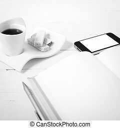 coffee cup with wafer, phone, notebook black and white color