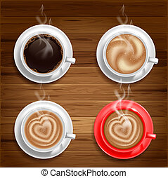 Coffee cups - Set of four coffee cups on wooden background....
