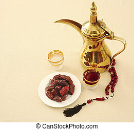 Coffee, dates and prayer beads - Arab coffee and dates with...
