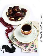 Coffee dates worry beads arab money
