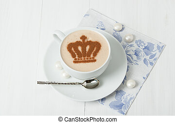 Coffee Decorated With Queen Crown. British Symbol Paper Napkin. Sweets. White Wooden Table.
