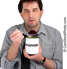Coffee Eater - Tired, dishevelled business man eating coffee...