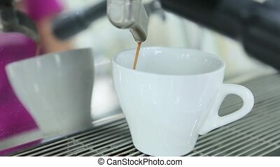 Coffee from coffee machine is poured into coffee.