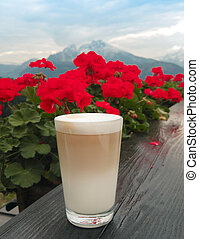 Coffee Glass with latte macchiato over Watzmann with red...