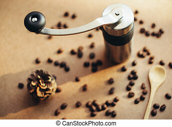 Coffee grinder and spoon with coffee beans, retro filter effect