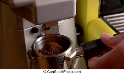 Coffee grinder clos eup. - Coffee grinder close up. Ground...