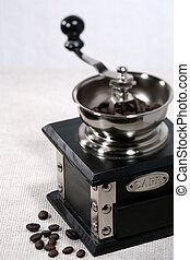Coffee grinder with beans, cuisine still life