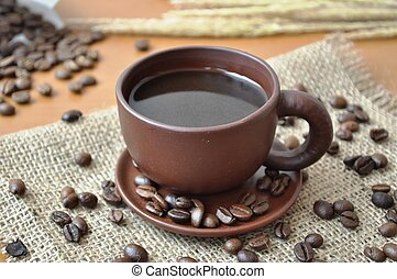 Coffee in a cup and coffee beans 4