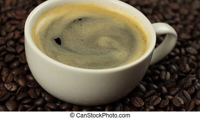 Coffee in a cup on coffee beans 1080p HD video