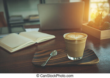 Coffee in a glass on wood table