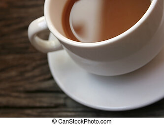 coffee in a white cup on wooden