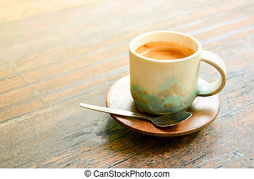 coffee in antique ceramic cup on wooden table