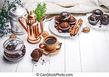 Coffee in clay cup with chocolate muffin