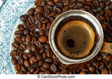 Coffee in copper turk on coffee beans