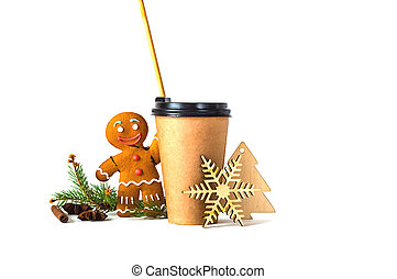 Coffee in paper cup with wooden straw and a gingerbread man on white background with Christmas decorations.