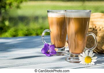 Coffee in the sunny summer garden