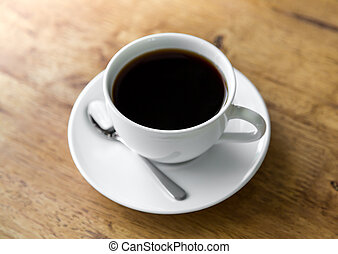 Coffee in white cup on wood table