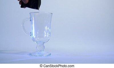 Coffee - Instant coffee is poured into a glass beaker