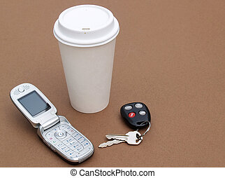 coffee, keys and cellular phone
