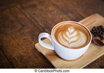 coffee latte with coffee beans in a sack on dark background, top view