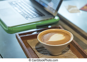 Coffee latte with notebook