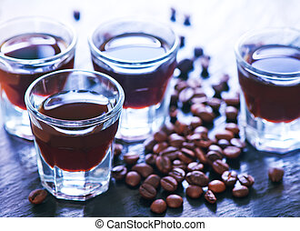 coffee liquor into small glasses and on a table