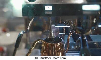 Coffee machine brewing hot fresh coffee close up.