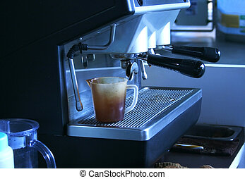 Coffee machine pouring cappuccino into a cup