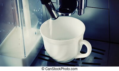 coffee machine pouring cappuccino in cup