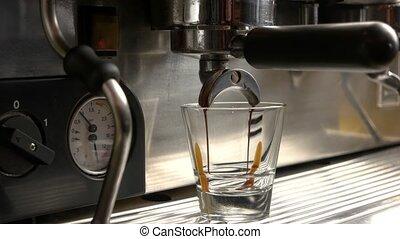Coffee machine pouring espresso.