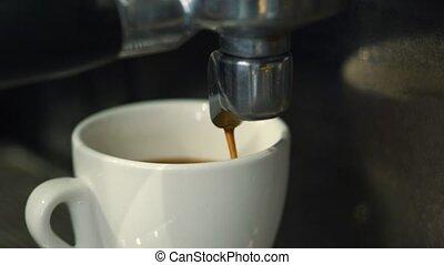 Coffee machine pouring espresso in cup