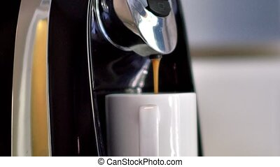 Coffee machine preparing coffee close-up. Freshly brewed...